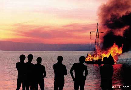 Thor Heyerdahl (center) and his 10-man crew burn their reed ship Tigris in protest of the wars raging in the Middle East. (Photo by Kon-Tiki Museum, Oslo)